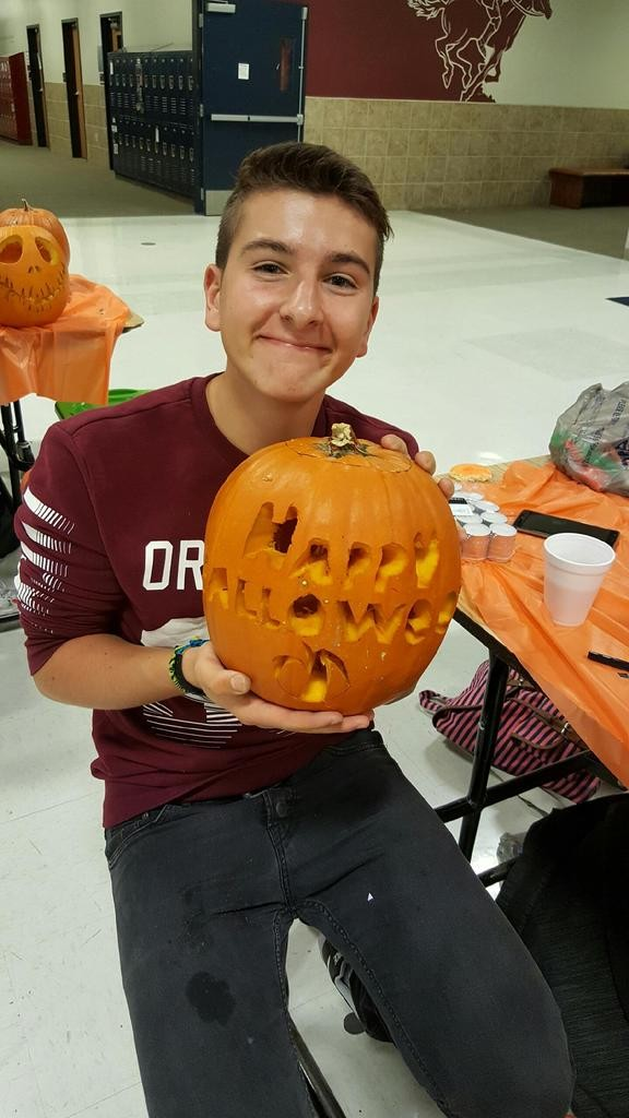 Luca posing for a pic with his awesome pumpkin.